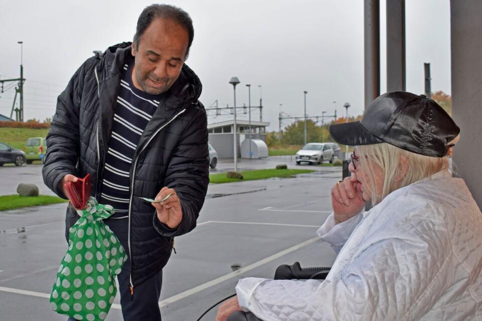 """""""What do you need today?"""", helpline volunteer Loui Alkafri asks."""