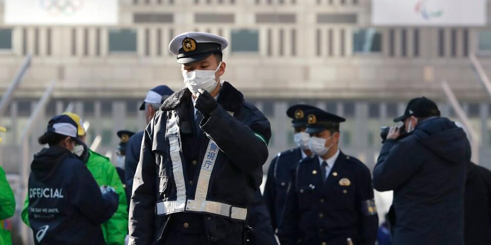 Kinesisk polis är rikligt förekommande på gatorna i Peking. Här i samband med ett maratonlopp som hölls i huvudstaden i början av mars i år.