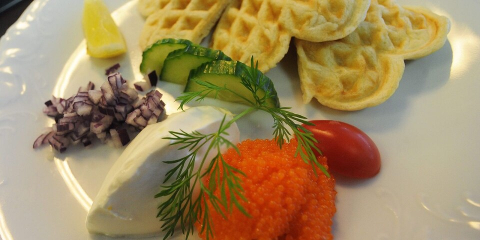 Waffles with roe, onion and sour cream.