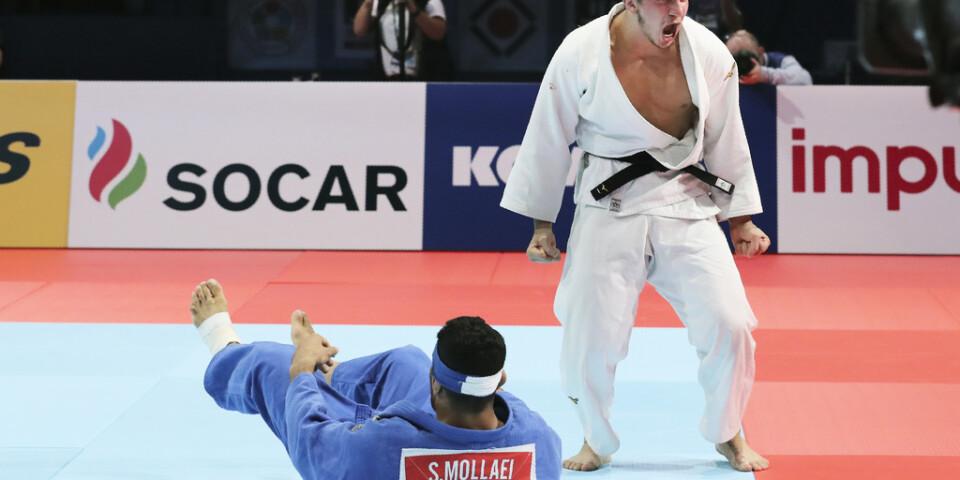Saeid Mollaei, i blått, förlorade mot georgiern Luka Majsuradze i bronsmatchen i VM i Tokyo i augusti.