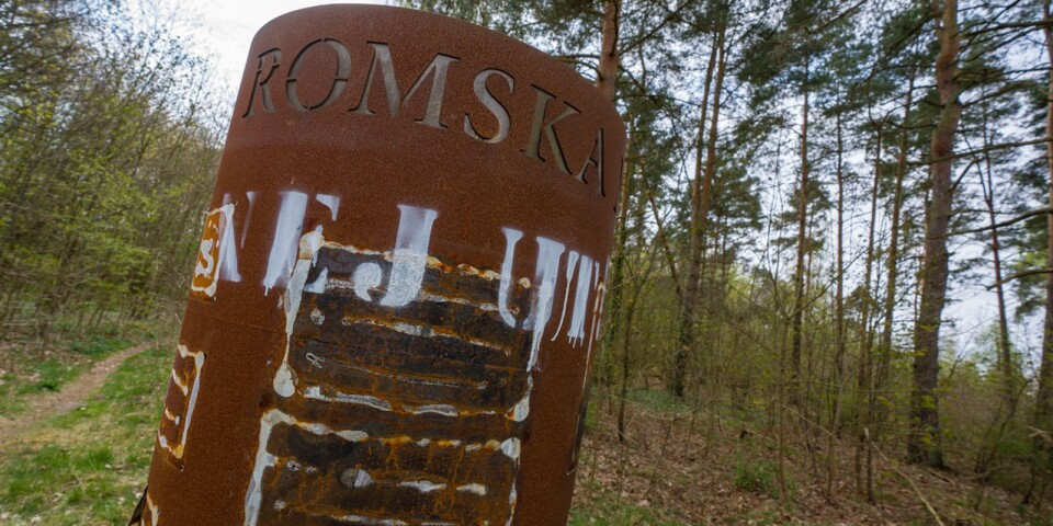 """The words """"Nej ut!"""" have been graffitied on the memorial at Skräbeån in Bromölla and the pictures that tell the history of the Roma people have been chipped off."""