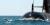 En delfin tar ett skutt framför australiska HMAS Dechaineux, en av de sex ubåtar som ritats och delvis byggts i Sverige.