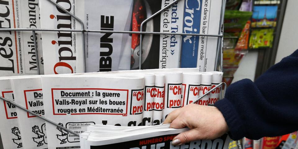 100 franska medieorganisationer har undertecknat ett upprop till stöd för yttrandefrihet efter att dödshot riktats mot anställda på satirtidningen Charlie Hebdo.