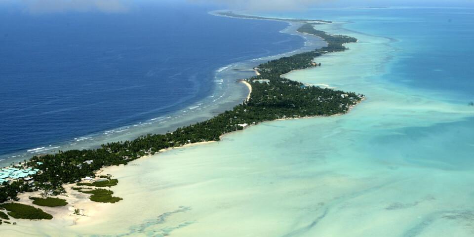 Kiribati består av låga korallöar, som hotas när havet stiger på grund av den globala uppvärmningen. Arkivbild