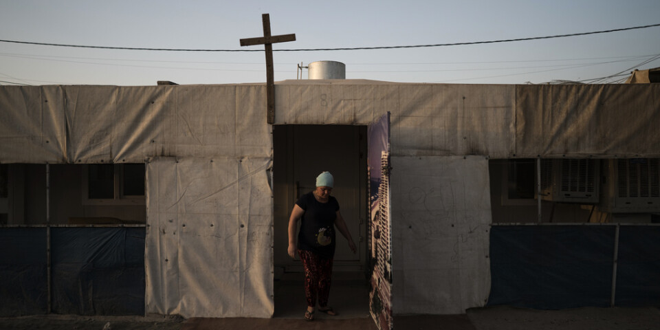 En kvinna i ett läger för kristna flyktingar i Erbil i Irak. Fyra anställda vid en organisation som arbetar för att hjälpa kristna i Irak har försvunnit i Bagdad. Arkivbild