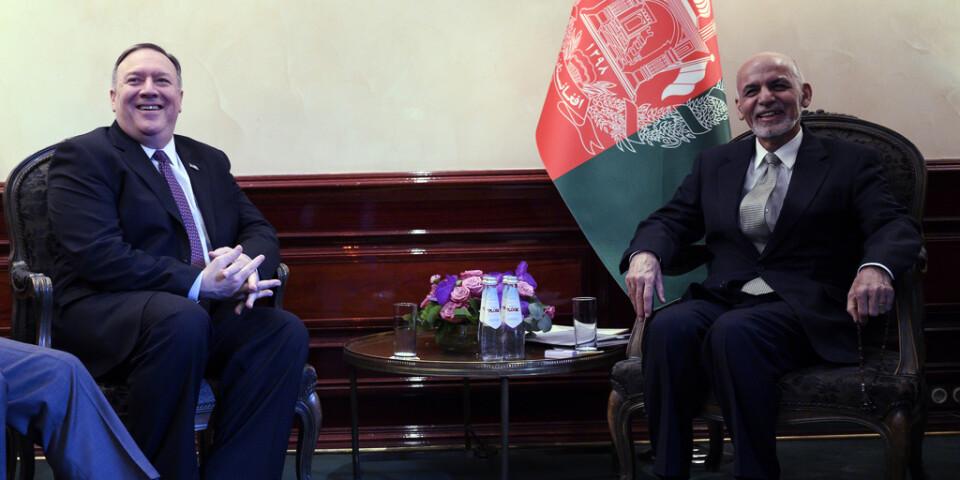 USA:s utrikesminister Mike Pompeo och Afghanistans president Ashraf Ghani under en säkerhetskonferens i tyska München på fredagen.